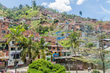 medellin: MEDELLIN, COLOMBIA - SEPTEMBER 4: Medellin cable car system connects poor neighborhoods in the hills around the city.