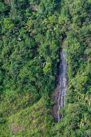 Waterfall in a valley of Magdalena river in Colombia
