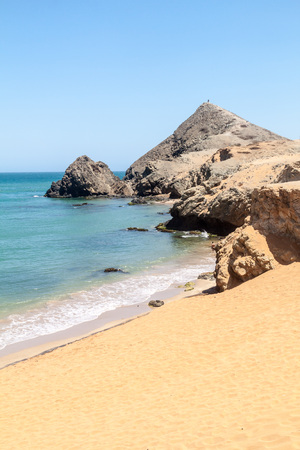 azucar: Coast of La Guajira peninsula in Colombia. Beach Playa del Pilon. Pilon de Azucar hill in the background.