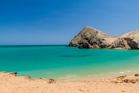 Coast of La Guajira peninsula in Colombia. Pilon de Azucar hill in the background. Stock Photo