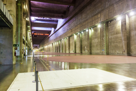electric generating plant: ITAIPU, BRAZILPARAGUAY - FEB 4, 2015: Generator hall of Itaipu dam on river Parana on the border of Brazil and Paraguay