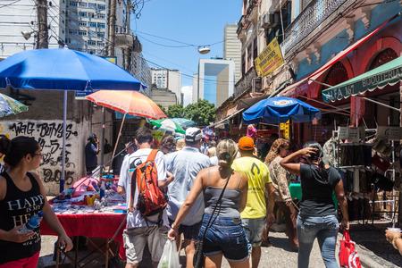 RIO DE JANEIRO, BRAZIL - JANUARY 28, 2015: People walk on a street in downtown of Rio de Janeiro, Brazil 新闻类图片