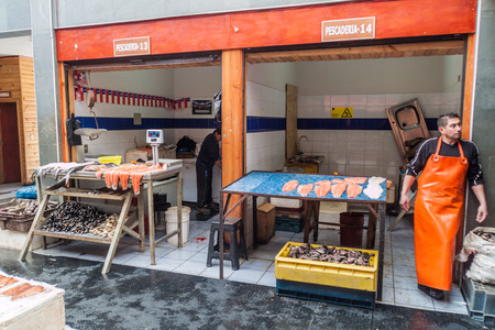 city fish market sign: ANCUD, CHILE - MARCH 20, 2015: View of seafood stall on market in Ancud, Chiloe island, Chile