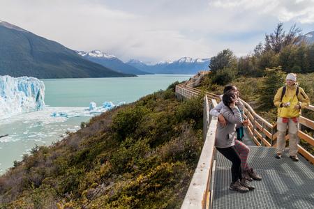 PERITO MORENO, ARGENTINA - MARCH 10, 2015: Tourists on boardwalks around Perito Moreno glacier, Patagonia, Argentina