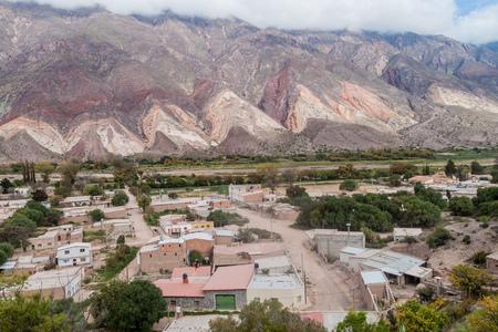 painter's palette: Village Maimara under colorful rock called Paleta del Pintor (Painters Palette) in Quebrada de Humahuaca valley, Argentina