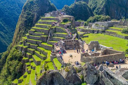 MACHU PICCHU, PERU - MAY 18, 2015: Crowds of visitors at Temple Zone of Machu Picchu ruins, Peru. Editorial