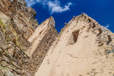 Ruins of Pinkulluna (Inca storehouses) above village Ollantaytambo, Sacred Valley of Incas, Peru