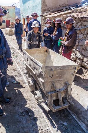 go inside: POTOSI, BOLIVIA - APRIL 20, 2015: Bolivian miners go to work inside Cerro Rico mine in Potosi, Bolivia. Editorial