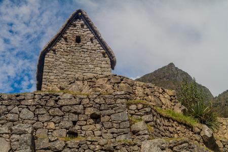 Building called guardhouse at Machu Picchu ruins, Peru. Stock Photo