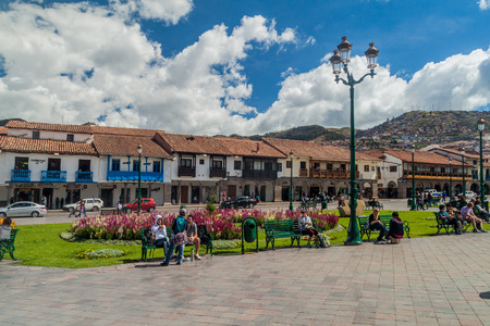 plaza de armas: CUZCO, PERU - MAY 23, 2015:  Colonial houses lining Plaza de Armas square in Cuzco, Peru. Editorial