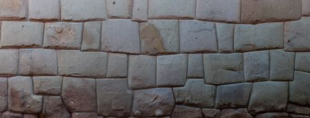 incan: Detail of Incas perfect stonework. Wall of former palace of Inca Roca in Cuzco, Peru. Stock Photo