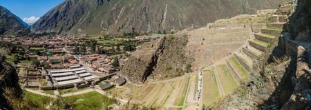 Agricultural terraces of Inca ruins and Ollantaytambo village, Sacred Valley of Incas, Peru