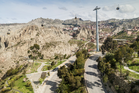 la paz: Traffic on the winding highway in La Paz, Bolivia. Teleferico (Cable car) in the background.