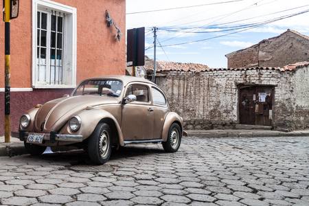 POTOSI, BOLIVIA - APRIL 19, 2015: Classic Volkswagen Beetle parked in a center of Potosi, Bolivia Editorial