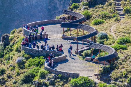 condor: CABANACONDE, PERU - MAY 27, 2015: Unidentified tourists at the Cruz Del Condor viewpoint.