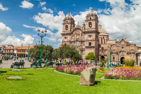 CUZCO, PERU - MAY 23, 2015:  La Compania de Jesus church on Plaza de Armas square in Cuzco, Peru.