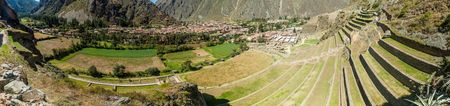Panorama of Inca agricultural terraces and village Ollantaytambo, Sacred Valley of Incas, Peru Stock Photo