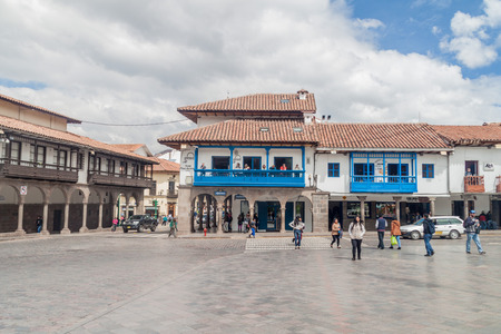plaza de armas: CUZCO, PERU - MAY 23, 2015: Colonial houses lining Plaza de Armas square in Cuzco, Peru. Stock Photo