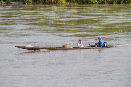 villagers: PANTOJA, PERU - JULY 9, 2015: Villagers on a dugout canoe called Peke Peke on a river Napo, Peru Editorial