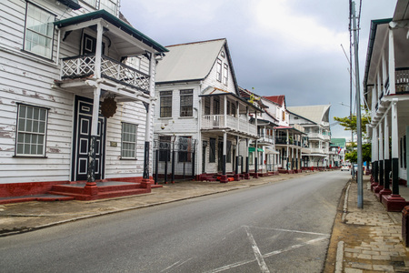 Street with old colonial buildings in Paramaribo, capital of Suriname.