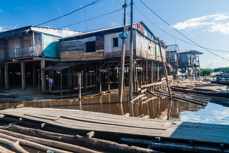 shantytown: IQUITOS, PERU - JULY 19, 2015: Surroundings of Bellavista Nanay port in Iquitos, Peru