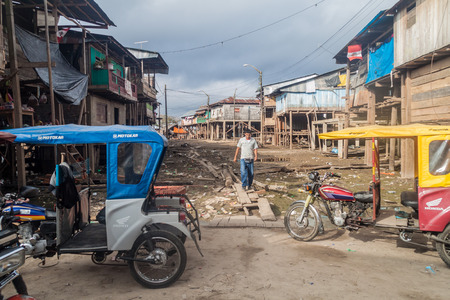 deprived: IQUITOS, PERU - JULY 18, 2015: View of partially floating shantytown in Belen neigbohood of Iquitos, Peru.