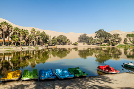 desert oasis: Small boats in desert oasis Huacachina near Ica, Peru Stock Photo