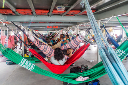 diamante: TABATINGA, BRAZIL - JUNE 22, 2015: Passengers of hammock deck at the boat Diamante which plies river Amazon between Tabatinga and Manaus, Brazil.