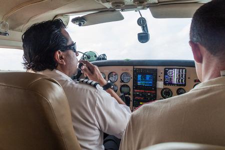 cessna: CIUDAD BOLIVAR, VENEZUELA - AUGUST 16, 2015: Pilot of a small Cessna 210 Centurion airplane at the airport of Ciudad Bolivar, Venezuela