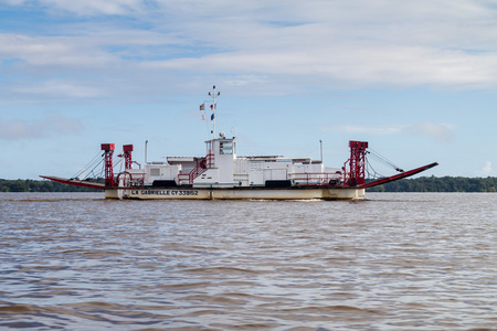laurent: ST LAURENT DU MARONI, FRENCH GUIANA - AUGUST 4, 2015: Ferry La Grabrielle crossing Maroni (Marowijne) river (to Suriname) in St Laurent du Maroni, French Guiana.