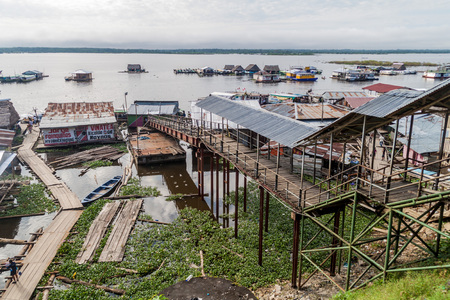 shantytown: IQUITOS, PERU - JUNE 17, 2015: View of a port Puerto de Productores in Iquitos, Peru Editorial