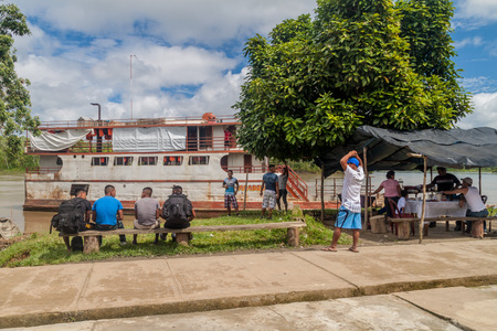 plies: PANTOJA, PERU - JULY 12, 2015: Cargo boat Arabela I plies river Napo, Peru Stock Photo