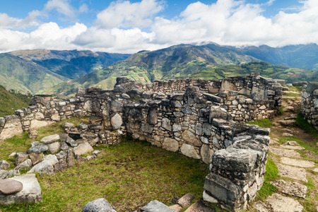 Remnants of round houses in Kuelap, ruined citadel city of Chachapoyas cloud forest culture in mountains of northern Peru.