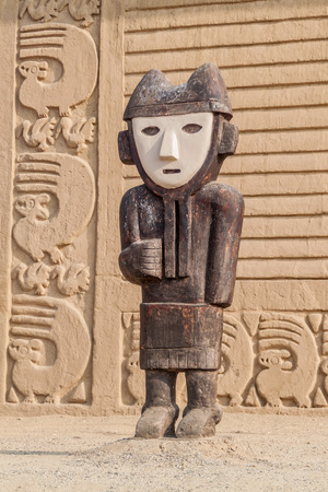 archeological: Wooden statue at archeological site Chan Chan in Trujillo, Peru