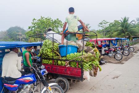 autorick: MAZAN, PERU - JUNE 17, 2015: Mototaxis waiting for customers in Mazan town, Peru