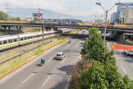 medellin: MEDELLIN, COLOMBIA - SEPTEMBER 2, 2015: Highway and metro tracks in Medellin.