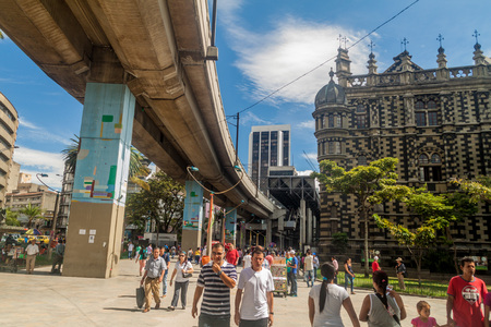 medellin: MEDELLIN, COLOMBIA - SEPTEMBER 1, 2015: Elevated metro line passes by Palace of Culture in Medellin.