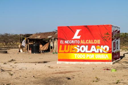 mayoral: CABO DE LA VELA, COLOMBIA - AUGUST 24, 2015: Mayoral election poster in a village Cabo de la Vela on La Guajira peninsula, Colombia.