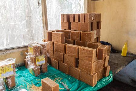 panela: OBANDO, COLOMBIA - SEPTEMBER 14, 2015: Panela bricks (unrefined whole cane sugar) in a small factory in Obando near San Agustin, Colombia Editorial