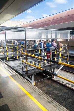 medellin: MEDELLIN, COLOMBIA - SEPTEMBER 1, 2015: Commuters at San Antonio station of Medellin metro. Stock Photo
