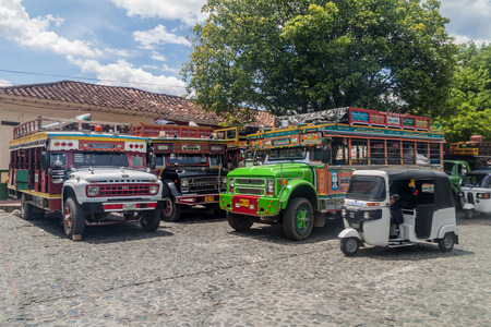 antioquia: SANTA FE DE ANTIOQUIA, COLOMBIA - SEPTEMBER 3, 2015: Colorful chiva buses are important part of rural public transport in Colombia.