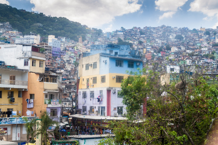 underprivileged: RIO DE JANEIRO, BRAZIL - JAN 29: View of favela Rocinha in Rio de Janeiro, Brazil Editorial