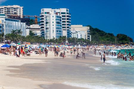 rio de janeiro: RIO DE JANEIRO, BRAZIL - JANUARY 27, 2015: People enjoy the famous beach Ipanema in Rio de Janeiro.