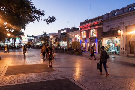 corrientes: CORRIENTES, ARGENTINA: FEB 11, 2015: People walk on a street in Corrientes, Argentina