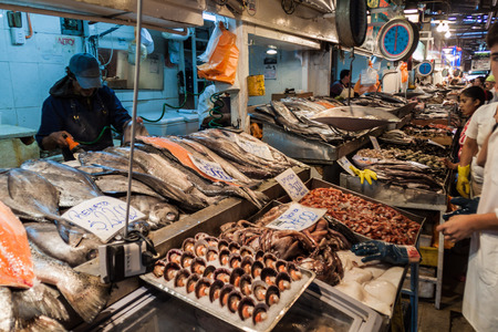 mercado central: SANTIAGO, CHILE - MARCH 28, 2015: Fresh fish and seafood on Mercado Central market in the center of Santiago, Chile
