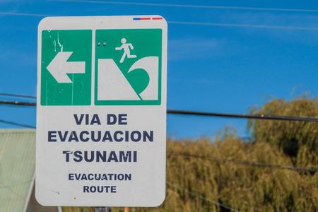 flood area warning sign: Tsunami Hazard Zone Sign in Achao village, Chile