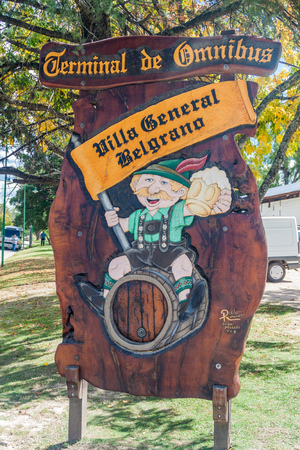 argentina dance: VILLA GENERAL BELGRANO, ARGENTINA - APR 3, 2015: Sign of bus terminal in Villa General Belgrano, Argentina. Village now serves as a Germany styled tourist sttraction.