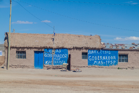 JULACA, BOLIVIA - APRIL 16, 2015: Election posters on a house in a small village Julaca, Bolivia. This village is located in a desert of southwestern Bolivia near salt plains of Uyuni.