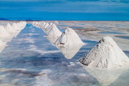 Hills of salt - salt extraction area at the worlds biggest salt plain Salar de Uyuni, Bolivia Stock Photo