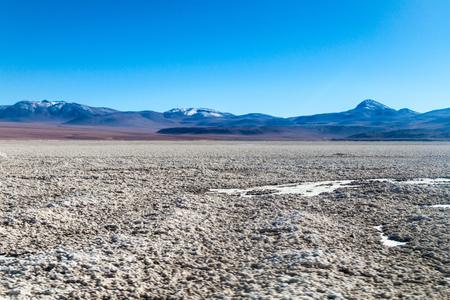 basin mountain: Borax is being mined from Salar de Chalviri salt flat in Bolivia Stock Photo
